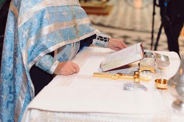 Priest Reading Bible