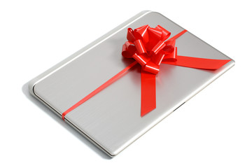 Top view of a laptop gift with a red ribbon