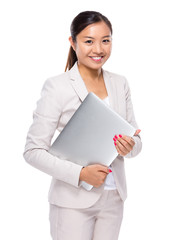 Asian businesswoman with notebook computer