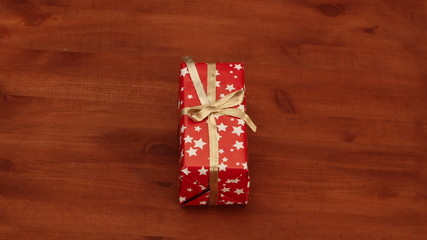 Christmas gifts changing on the wooden desk