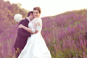 Happy bridal couple in lavander fields