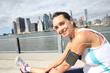 canvas print picture - Woman stretching out after running on Brooklyn Heights promenade
