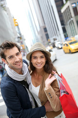 Portrait of cheerful couple doing shopping in Manhattan
