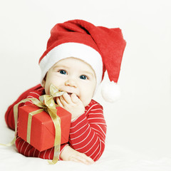 Happy baby in Santa hat