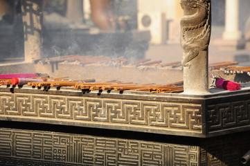Burning incense stick, traditional buddhism ceremony in China.