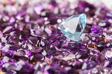 Natural Topaz stone on background of natural amethyst