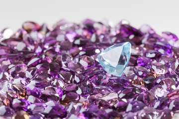 Natural topaz on background of natural amethyst