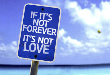 If It's Not Forever It's Not Love sign with a beach background