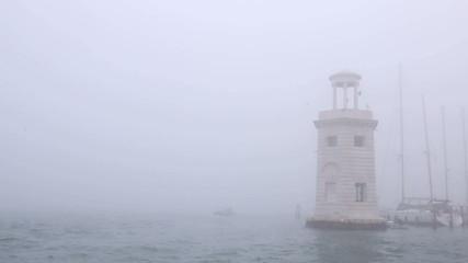 Lighthouse in the fog, Venice, Italy
