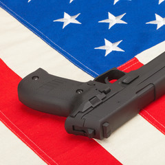 Handgun laying over USA flag