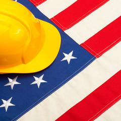 Construction helmet over US flag