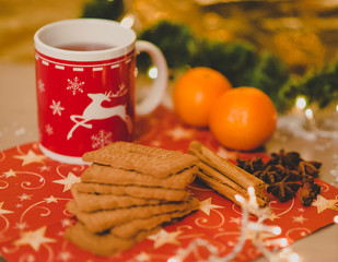 christmas tea with biscuits, cinnamon, anis stars and tangerines