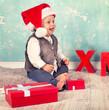 canvas print picture - lachendes Baby mit Weihnachtsdekoration