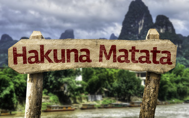 Hakuna Matata sign with a forest background