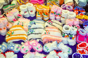 Knitted woolen baby shoes and hats
