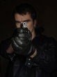 Young man holding a gun