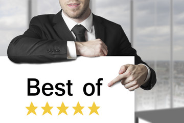 businessman pointing on sign best of