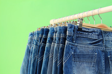 Row of hanged blue jeans