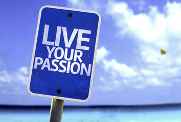 Live Your Passion sign with a beach on background