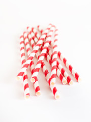 Paper drink straws on white background