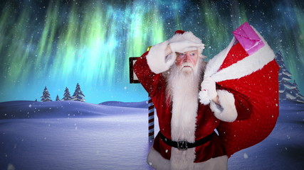 Santa delivering presents at the north pole