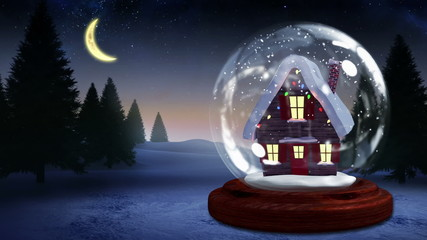 Cute christmas house inside snow globe