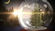 Christmas tree inside snow globe with magic greeting in german