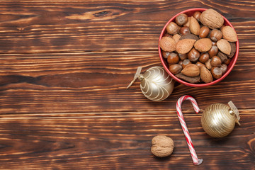 Bowl Of Whole Nuts. Wooden Background