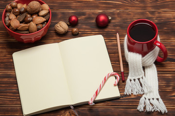 Open Notepad. Mug Of Tea With Scarf. Wooden Background