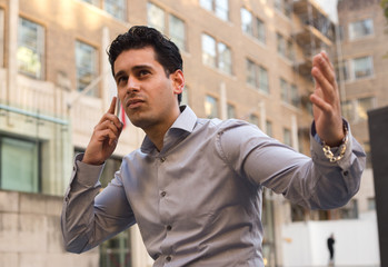 young business man hearing bad news on the phone