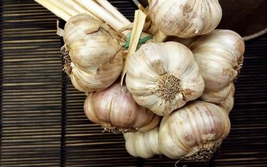 braid of garlic on black background