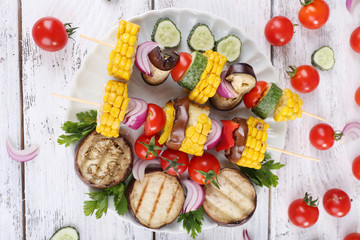 Sliced vegetables on picks on plate on table close-up