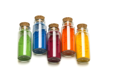 Colored powder in glass bottle