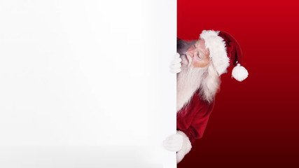 Santa peeking around gift card on festive background