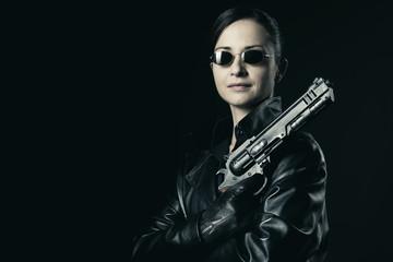 Attractive female agent with raised gun