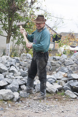 old man with big hammer