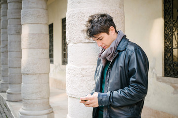 Young man in the street with the phone