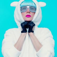 fashion girl in hoodie Teddy Bear on a blue background. vanilla