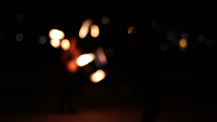 People dancing with fire