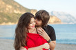 Young happy couple in love outdoor portrait