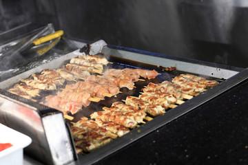 Cooking of shish kebab on skewers