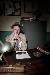 Detective smoking at desk