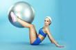 Training. Athletics. Woman in Sportswear with Fitness Ball