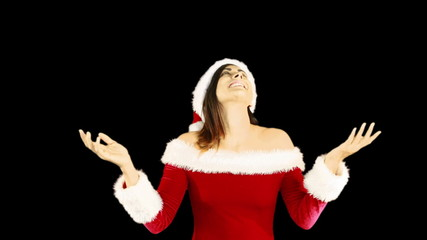 Joyful santa girl looking up and smiling at camera