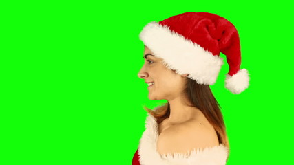 Sexy santa girl blowing over hands