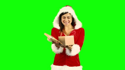 Sexy girl in santa costume opening a gift