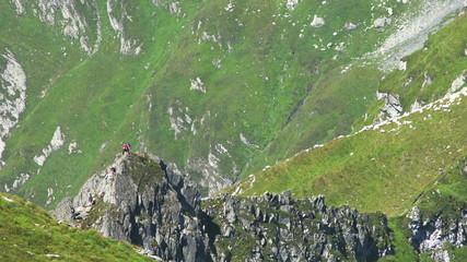 Trekkers on dangerous path in Carpathian Mountains