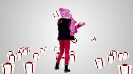 Festive little girl under falling christmas gifts