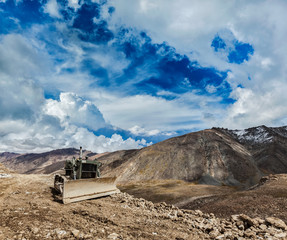 Bulldozer on road in Himalayas