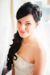 Happy beautiful bride girl in white wedding dress